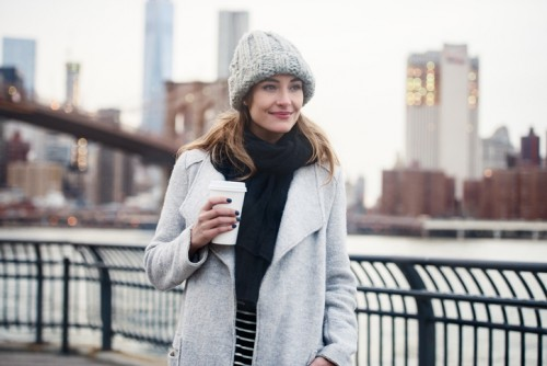 Beautiful woman walking with a coffee cup in New York City