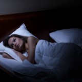 Woman suffering from depression at night, horizontal