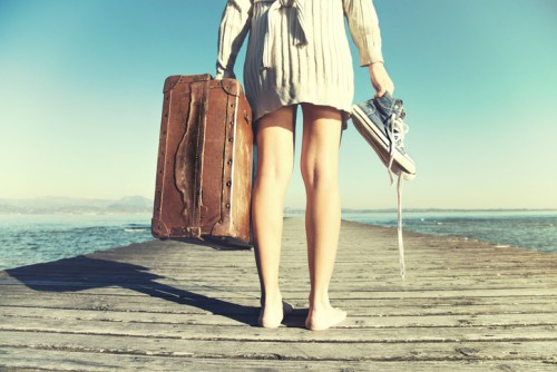 traveler woman just arrived to destination with her suitcase